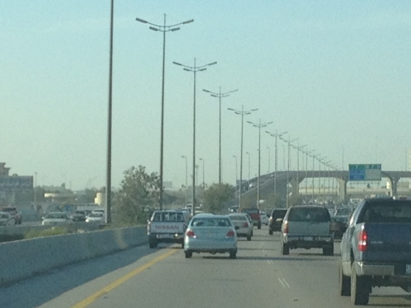 Shoulder driving. All these cars are in motion!! The one on the shoulder is zooming past everyone.